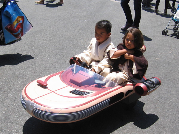 Kids ride a Star Wars speeder through the Gaslamp!