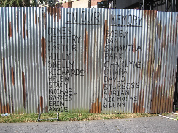 A fence near the Deadquarters entrance lists victims of the undead.