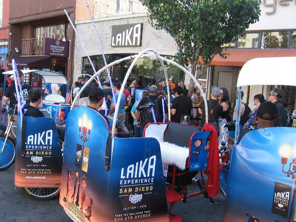 Lots of pedicabs on Fifth Avenue promoting the Laika Experience are in front of that cool exhibit.