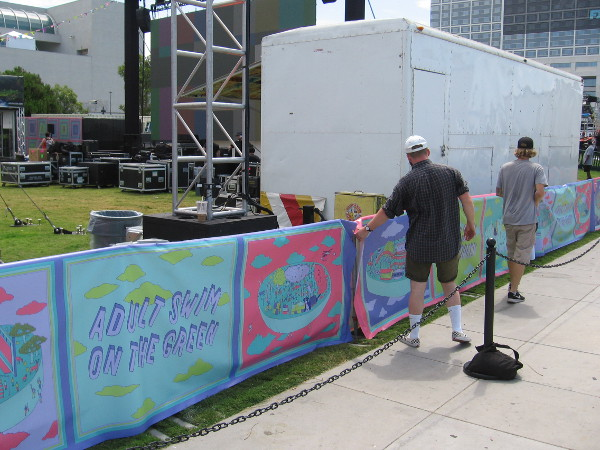Some final adjustments to banners enclosing the Adult Swim on the Green.