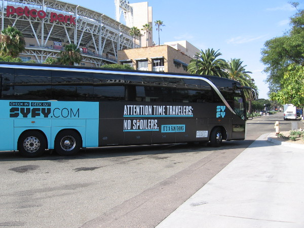 A Syfy bus wrap proclaims--Attention Time Travelers: No Spoilers.
