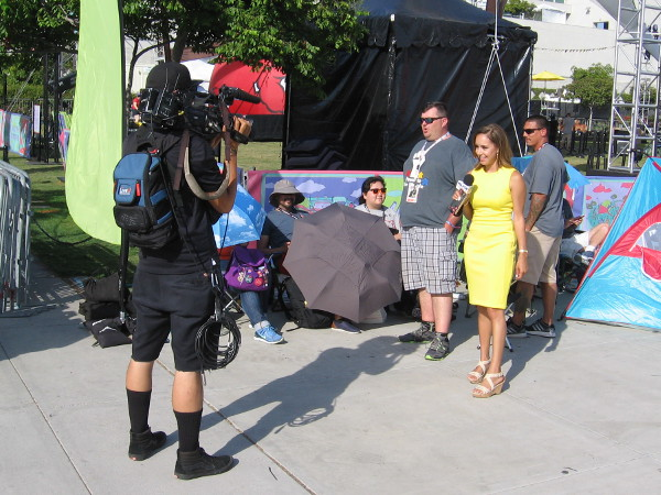 Television reporter Ashlie Rodriguez of KUSI gets ready to interview the person first in line for Hall H.