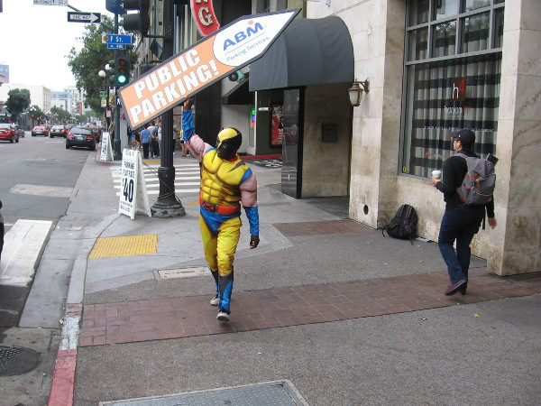I spotted Wolverine spinning a parking sign near Horton Plaza.