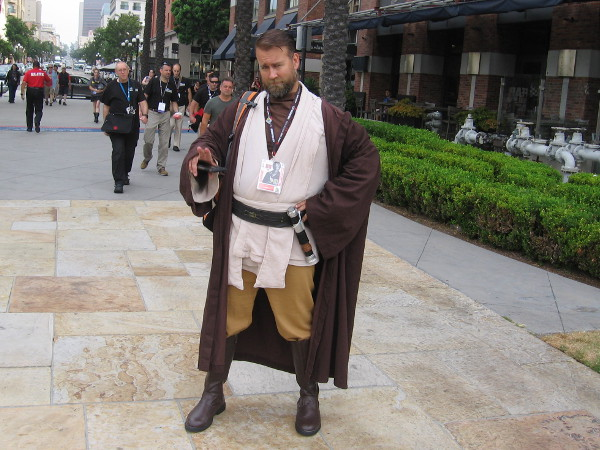 Obi-Wan Kenobi cosplay. Observe his fingers. He's ready to play a Jedi mind trick on me!