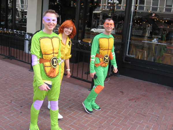 Have no fear! The Teenage Mutant Ninja Turtles are coming down the sidewalk!
