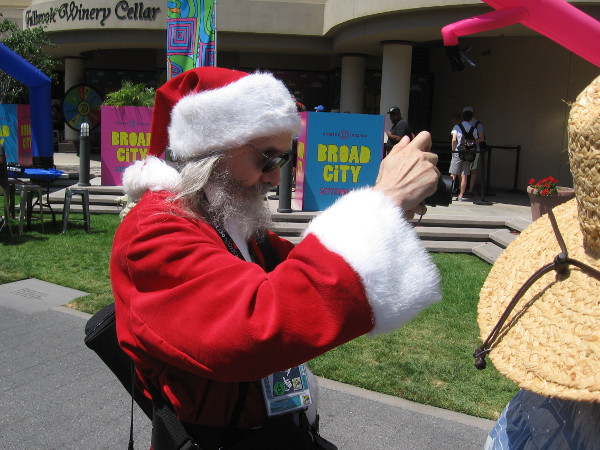 Santa Claus is busy taking a photo of something up ahead...