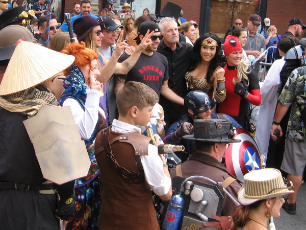 A group shot with cosplayers and celebrities.