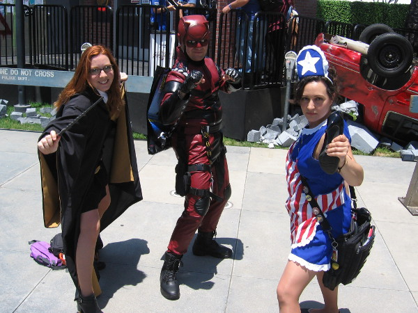 Cosplays of Hermione, Daredevil, and American Maid from The Tick.