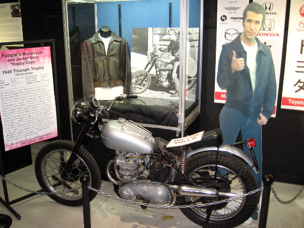 Fonzie's motorcycle and leather jacket from Happy Days is on display at the San Diego Automotive Museum in Balboa Park!