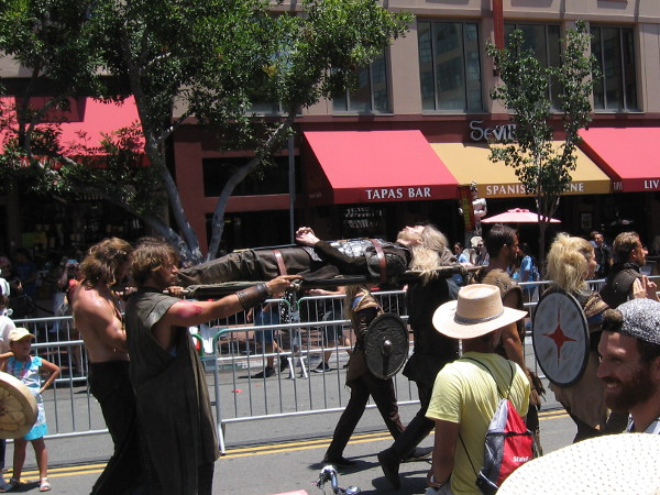 The dead body of a heroic Viking warrior is carried down Fifth Avenue for Comic-Con.