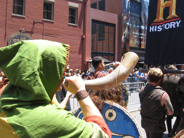 Horn blows during the Viking funeral procession.