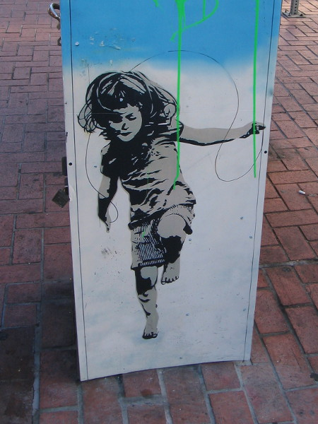 Girl jumps rope. Street art on a utility box in San Diego's Gaslamp Quarter.