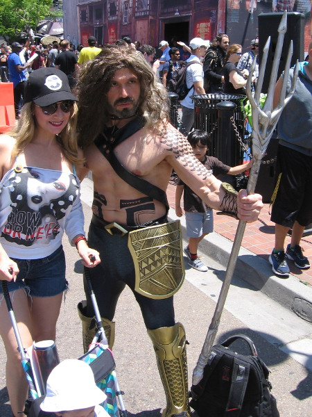 A fan poses with another cosplay Aquaman.