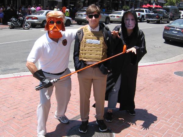 Orange Golf Vader and other assorted weird, unknown villains lie in wait on the sidewalk.