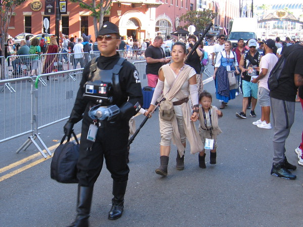 A happy Star Wars family heads down Fifth Avenue in the Gaslamp during 2017 Comic-Con.