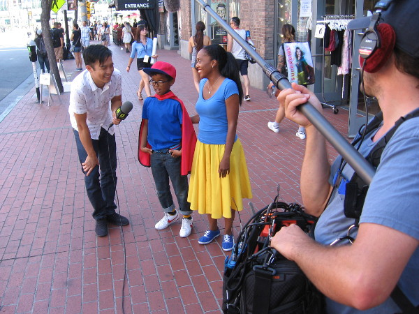 Reporter for the Syfy Wire interviews a kid about the coolness of San Diego Comic-Con!