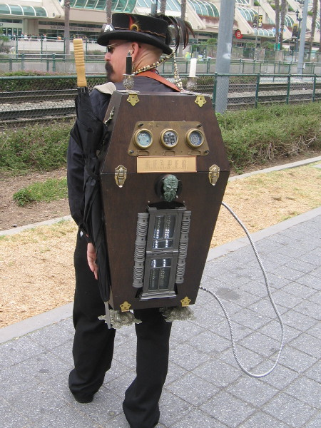 A steampunk Ghostbuster shows me his very cool proton pack.