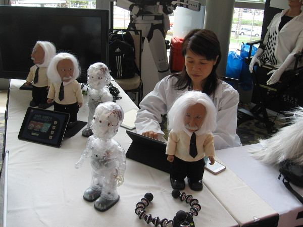 These interactive Professor Einstein robots challenge people with brain games.