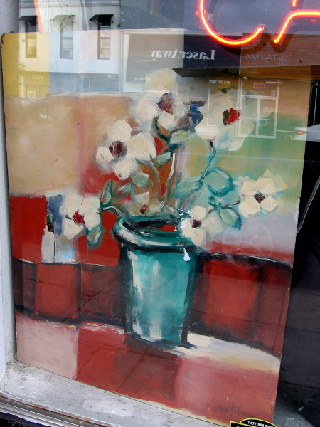 Painted flowers inside a downtown window.
