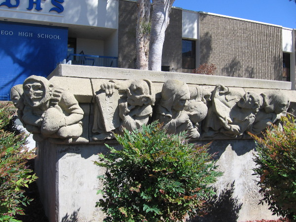 Old sculptural figures surround a planter at San Diego High School, near Park Boulevard. They depict academic and athletic endeavors.