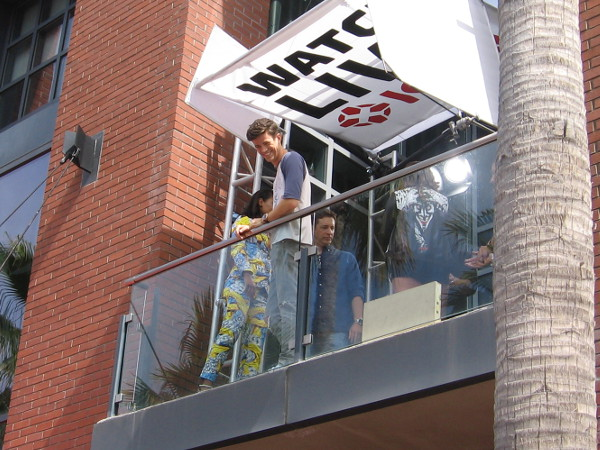 Actor Grant Gustin, who plays the superhero Flash on CW looks down on the Comic-Con crowd from a Hard Rock Hotel balcony.