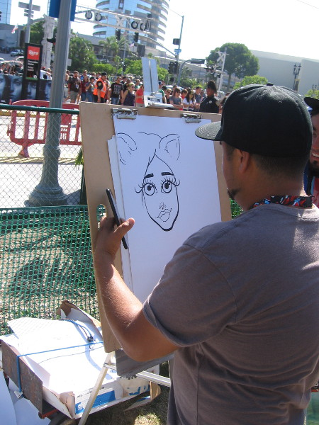 A caricature artist at work on MLK Promenade.