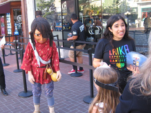 Kubo greets passersby in San Diego's Gaslamp Quarter. A free exhibit by Laika Entertainment demonstrates their animation process and includes puppets, sets and props.