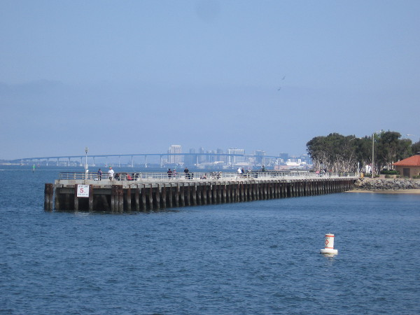 The fishing pier of nearby Bayside Park lies to the north across Chula Vista Harbor's entrance. I see the Coronado Bay Bridge and downtown San Diego in the distance!