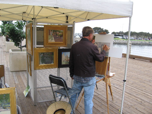 Plein air painter Paul Strahm creates a beautiful work of art near the USS Midway Museum.