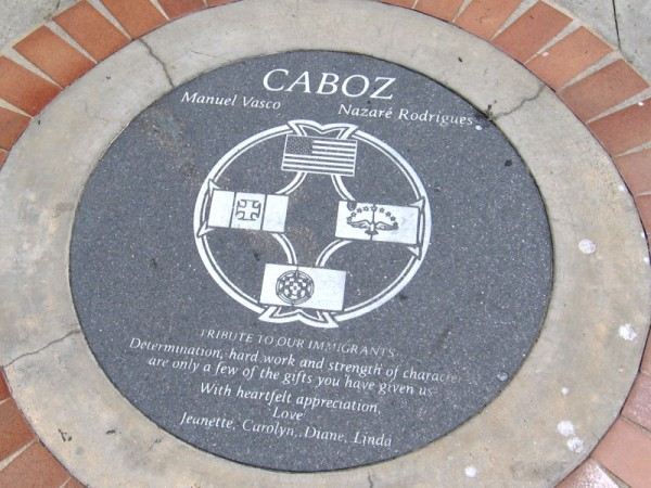 Plaque in the sidewalk is a Tribute to our Immigrants. Determination, hard work and strength of character are only a few of the gifts you have given us.