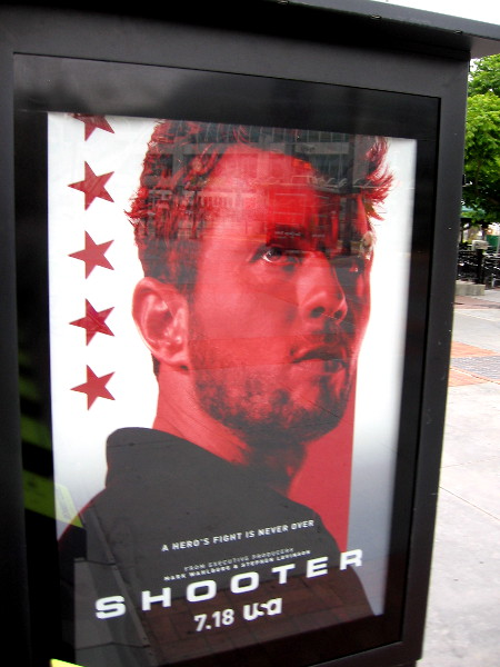 A poster promoting Shooter on USA Network near the Tin Fish.