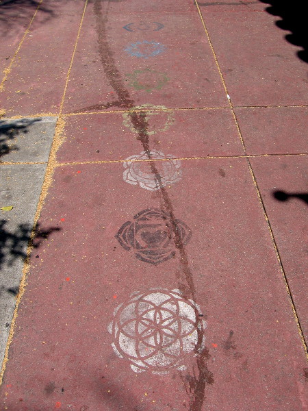 Stenciled mandalas line the sidewalk near Pilgrimage of the Heart Yoga.