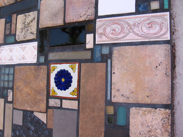 A mosaic of different tiles outline the front of some stores along Adams Avenue in Normal Heights.