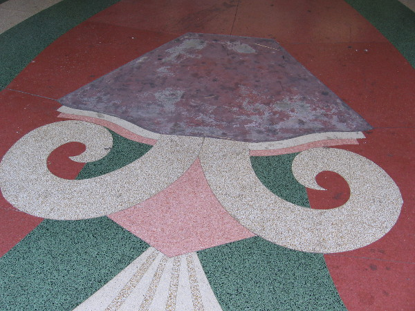 Colorful terrazzo design at entrance to old theater.