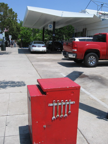 Real wrenches have been affixed to this utility box near an auto repair shop!