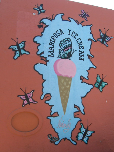 Butterflies are flitting about the wall of Mariposa Ice Cream.