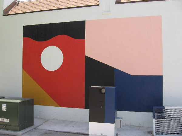 Abstract mural incorporates nearby utility boxes.