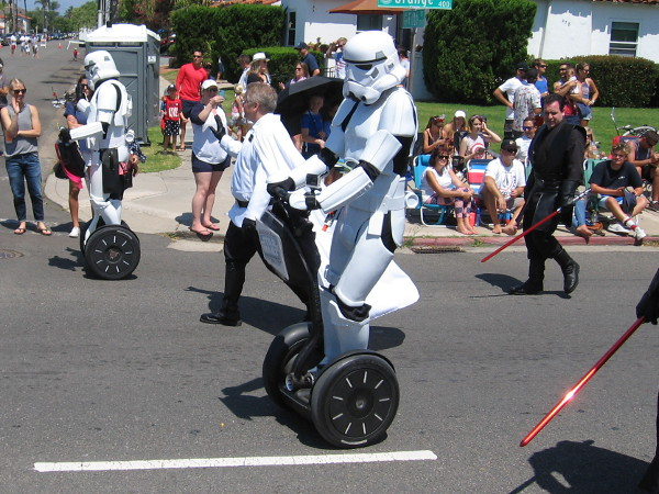 Star Wars stormtroopers on Segways patrol the parade route during the Fourth of July in Coronado.