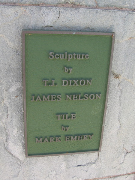 Plaque reads Sculpture by T.J. Dixon and James Nelson. Tile by Mark Emery.