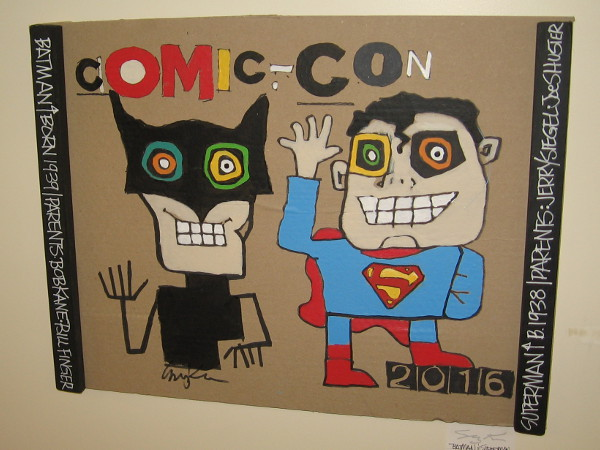 Fun versions of Batman and Superman welcome everyone to Comic-Con!