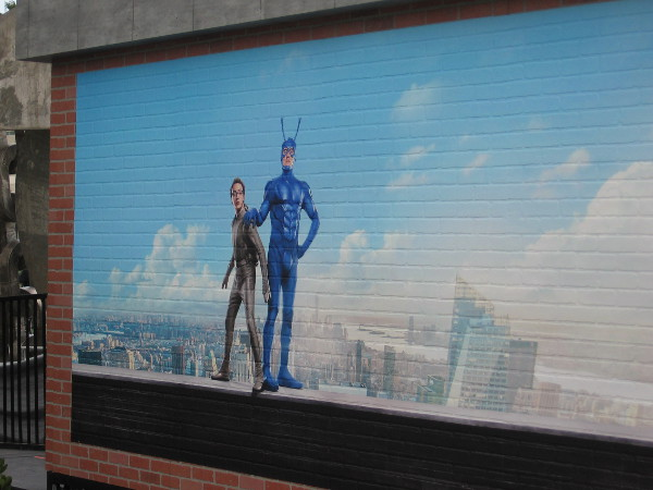 Graphic on rear of The Tick Takeover building shows Arthur Everest and The Tick.