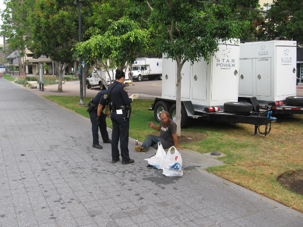 Everybody is getting ready, including the police. Homeless are removed from the area before Comic-Con.