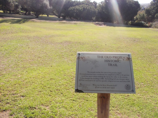 Sign marks the Old Presidio Historic Trail. Grassy mounds on the hill below the Serra Museum are the ruins of the old presidio chapel.