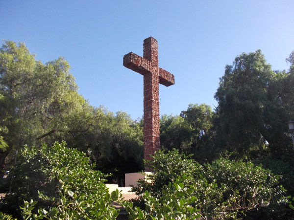 A large cross marks the location of the first Spanish mission in Alta California, established by Junipero Serra.