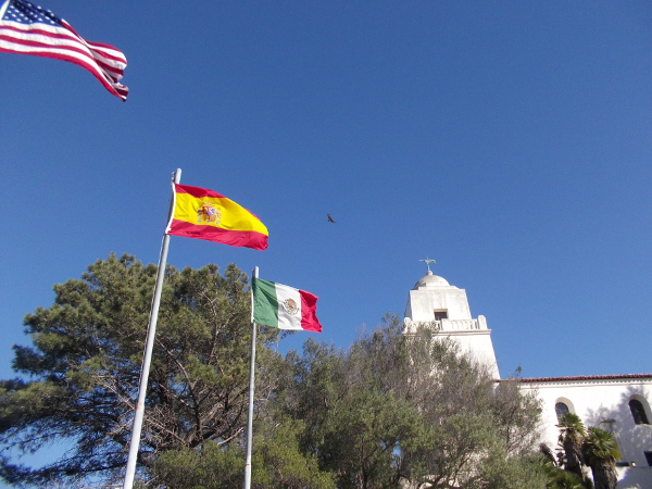 Flags of the United States, Spain and Mexico fly atop Presidio Hill, birthplace of California. Here many chapters of history are remembered.