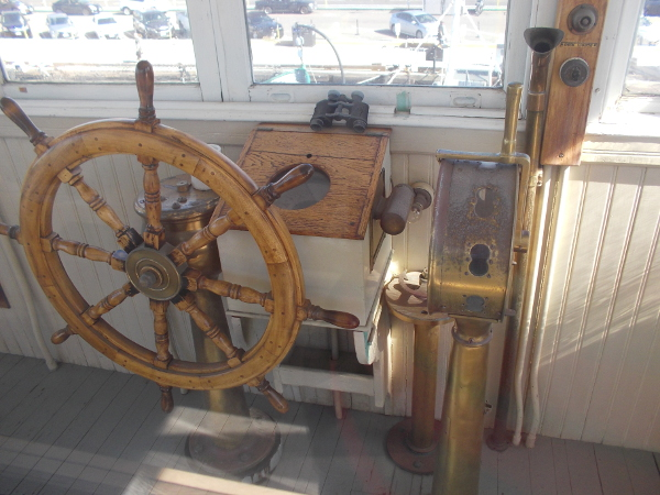 The wooden wheel, binoculars and other instruments used to pilot the ferry.
