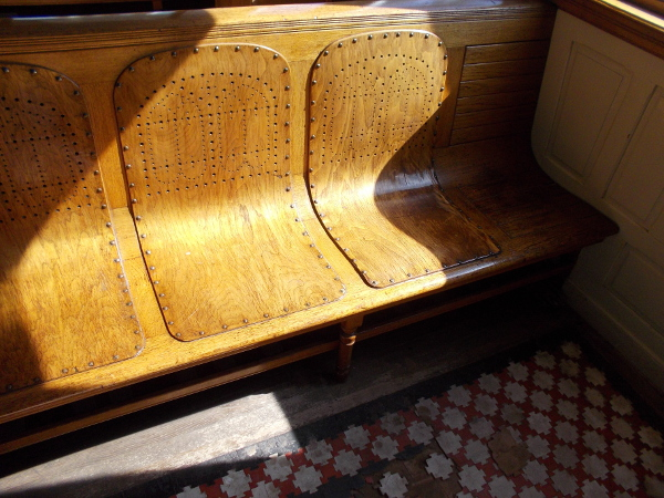 Sunlight on one comfortable, warm wood bench. Wouldn't you like to sit here?