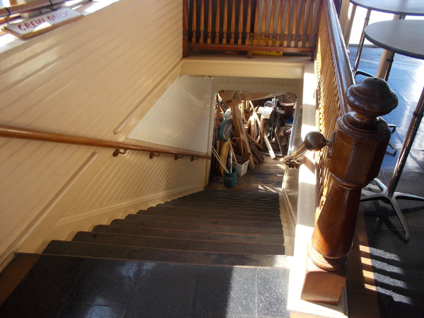 Gazing down some steps at a museum workshop aboard the Berkeley.