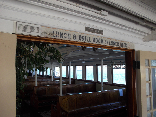 An old sign above one doorway says a Lunch and Grill Room are on the Lower Deck.