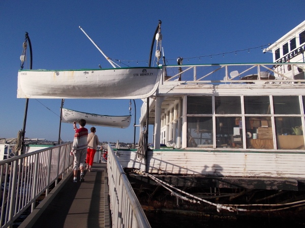 People walk through history aboard a beautiful old vessel.